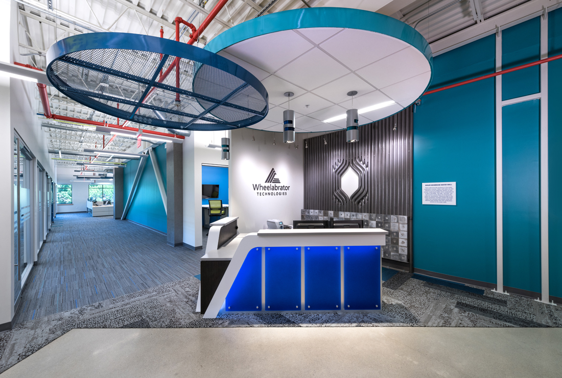 •	Reception area at Wheelabrator Technologies' new corporate headquarters, Portsmouth, N.H. (JS Photography)